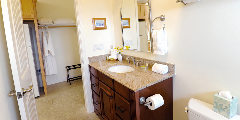 Large bathroom with granite slab counter tops