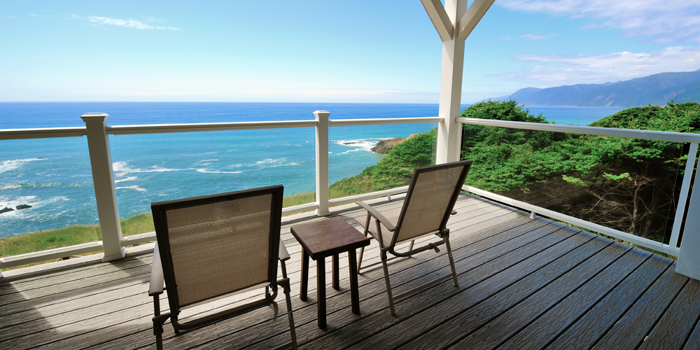 Our Spyglass suite features a large deck with a beautiful ocean view.